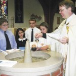 Priests Are Added Blessing to Schools