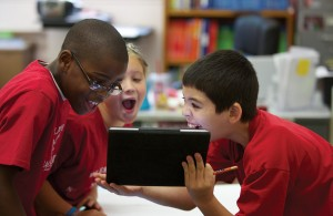 photo of students with iPad