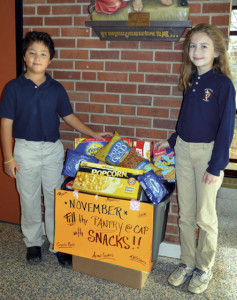 Holy Cross School students with school supplies for CAP students