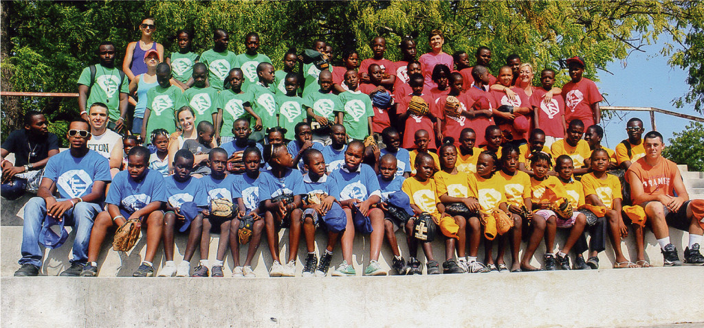 Seton Catholic senior Connor McCormack, second row, second from left, taught children in Haiti the game of baseball  during a mission  trip last summer.