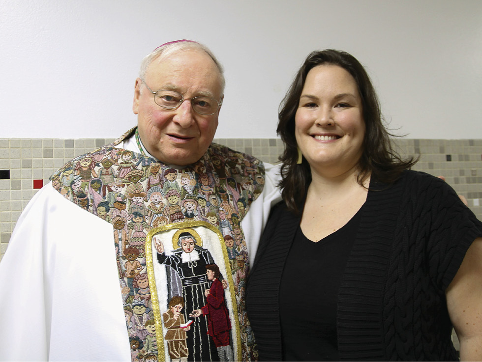 Kate Mahoney stands with Auxiliary Bishop Emeritus Thomas Costello.