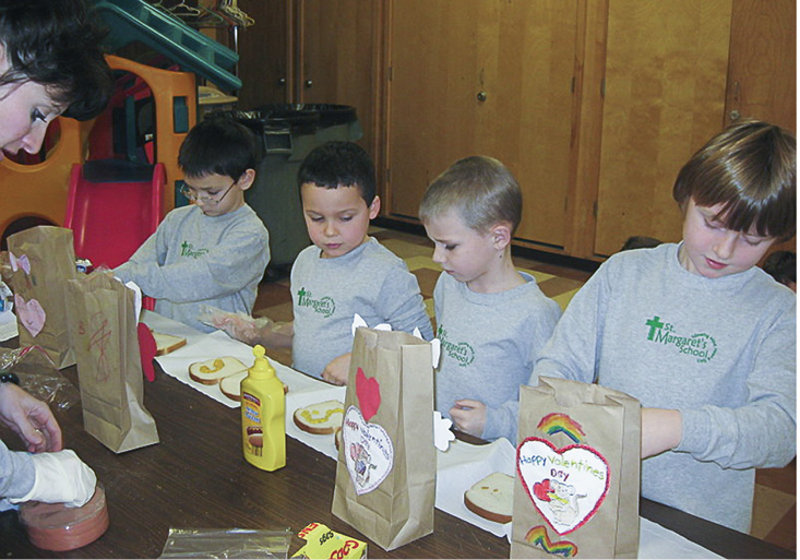 St. Margaret's School student make sandwiches