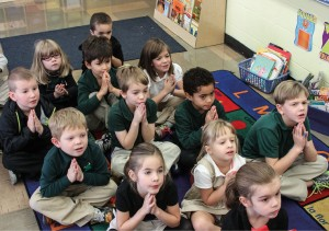 Photo of kids praying