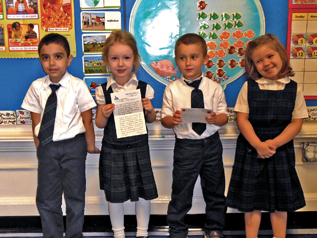 Photo of kids with pen pal letters