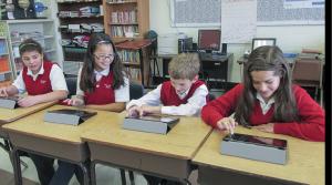 Digital Natives, photo of kids using tablets