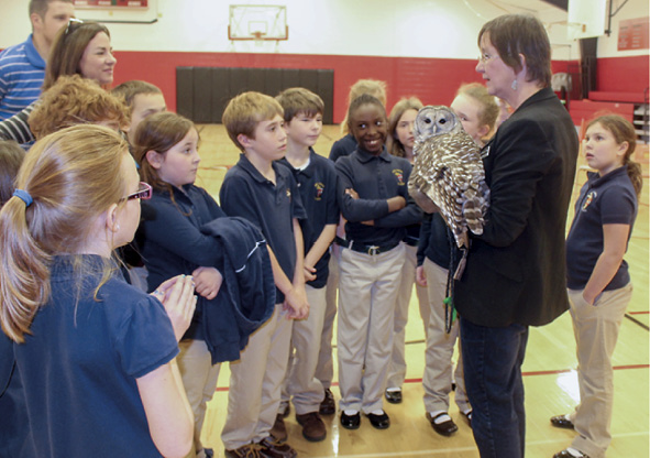 Students at Holy Cross School meeting owls